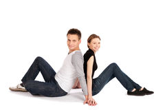 Happy Casual Couple Sitting Stock Image