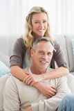 Happy casual couple smiling and hugging Stock Photography