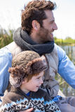Happy casual father and son at a lake Royalty Free Stock Photos