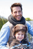 Happy casual father and son at a lake. In the countryside Stock Image