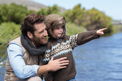 Happy casual father and son at a lake. In the countryside Royalty Free Stock Photos