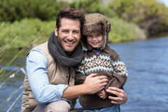Happy casual father and son at a lake. In the countryside Royalty Free Stock Photo
