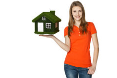 Female holding green eco house. Happy casual female showing eco house, isolated over a white background Stock Image