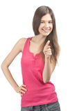 Happy casual girl pointing and smiling Stock Images