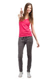 Happy casual girl showing thumbs up Royalty Free Stock Images