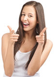 Happy casual girl showing thumbs up and pointing Royalty Free Stock Images