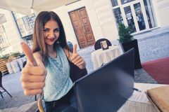 Happy casual girl showing thumbs up and smiling Royalty Free Stock Photo
