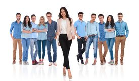 Happy casual group with businesswoman leader walking in front. Happy young casual group with businesswoman leader walking in front of them on white background royalty free stock images