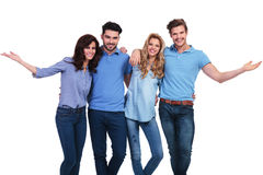 Happy casual group of casual people welcoming you. To the team on white background Stock Image