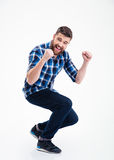 Happy casual man celebrating his success Royalty Free Stock Photography