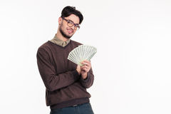 Happy casual man in glasses hlding money Royalty Free Stock Photos
