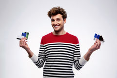 Happy casual man holding credit cards Stock Photo