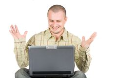 Happy casual man with laptop. Isolated on white background Royalty Free Stock Photo