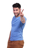 Happy casual man making the victory sign Royalty Free Stock Images