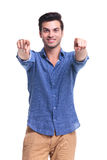 Happy casual man poining fingers. To the camera on white background Stock Photography