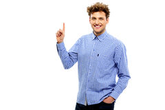 Happy casual man pointing upwards Stock Photography