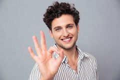 Happy casual man showing ok sign Stock Image