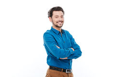 Happy casual man standing with arms folded. Isolated on a white background Royalty Free Stock Images