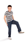 Happy Casual Man Standing on One Leg Royalty Free Stock Photography