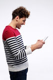 Happy casual man using tablet computer Royalty Free Stock Image