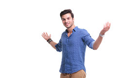 Happy casual man welcoming you Stock Photography