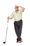 Happy casual mature golfer looking for ball Royalty Free Stock Photography
