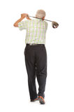 Happy casual mature golfer swinging a club Stock Photos