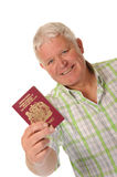 Happy casual mature man with passport Royalty Free Stock Photography