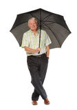 Happy casual mature man with umbrella Stock Photo