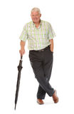Happy casual mature man with umbrella Royalty Free Stock Images
