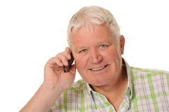 Happy casual mature man using mobile phone Stock Photos