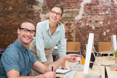 Happy casual photo editors at work in office Royalty Free Stock Photography