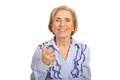 Happy casual senior woman with perfume Royalty Free Stock Image