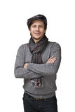 Happy casual smiling man in hat and scarf isolated over a white royalty free stock images