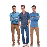 Happy casual team of three confident men stock photography