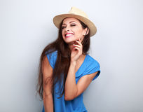 Happy casual toothy laughing woman in summer hat on blue backgro. Und Stock Photography