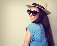 Happy casual toothy laughing woman in summer hat and sunglasses. Royalty Free Stock Images