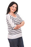 Happy casual woman with arms folded Stock Images