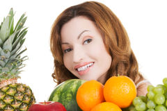 Happy casual woman with fruits. Royalty Free Stock Photography