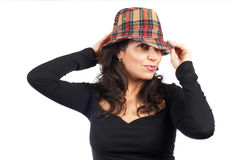 Happy casual woman with hat. Portrait of a smiling casual woman with hat, over a white background Royalty Free Stock Image