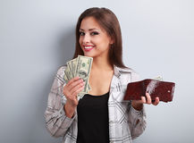 Happy casual woman holding dollars and wallet in hands and want Stock Photos