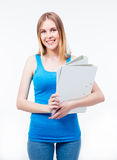 Happy casual woman holding folders Royalty Free Stock Image