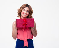 Happy casual woman holding gift box Stock Photography