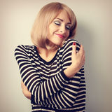 Happy casual woman hugging herself with natural emotional on enj Royalty Free Stock Images