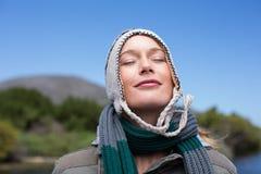 Happy casual woman at a lake Stock Image