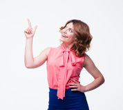 Happy casual woman pointing finger up Royalty Free Stock Photography