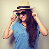 Happy casual woman posing in sunglasses and fashion summer hat. Royalty Free Stock Image