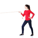 Happy casual woman pulling a rope with ease. Isolated on white royalty free stock photos