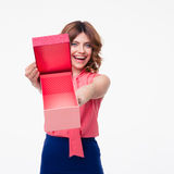 Happy casual woman showing empty gift box Royalty Free Stock Image