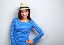 Happy casual woman in straw hat looking happy. On blue background Royalty Free Stock Photos